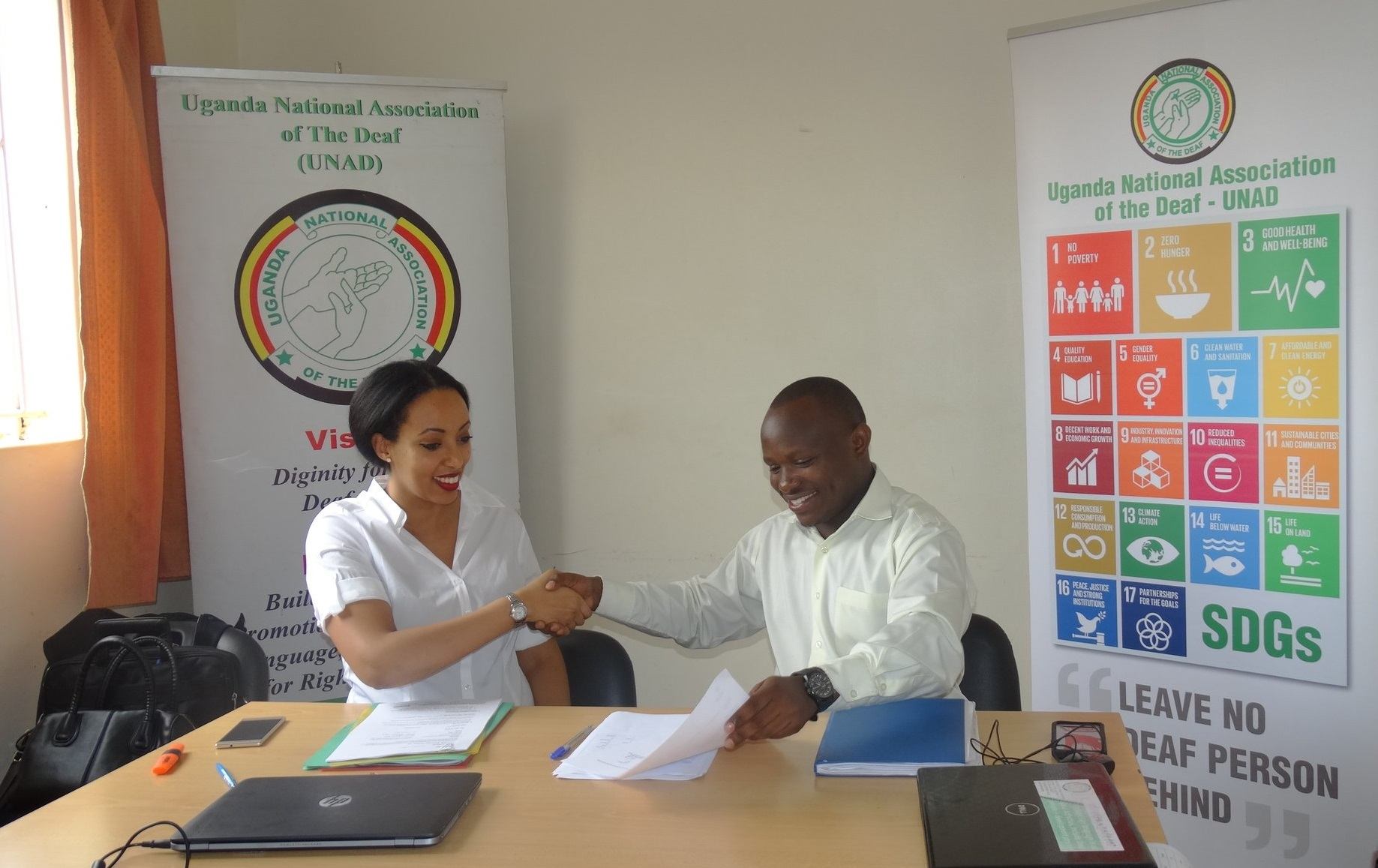 Spider programme manager, Magda Berhe Johnson and UNAD's Ambrose Murangira signing the project agreement